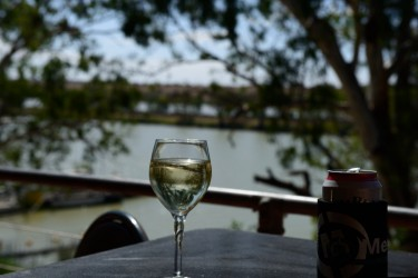 A glass of wine and a bourbon on the table at the Swan Reach pub overlooking the Murray River and lagoons