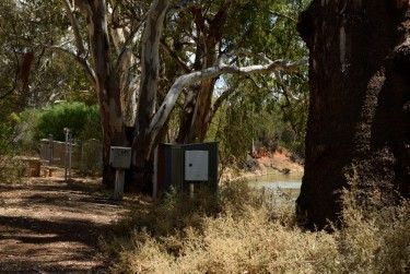 A row of pumping stations beside the Murray River