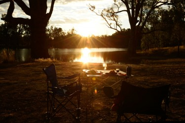 Our dinner table set up by the Murray River with the sunsetting in the background