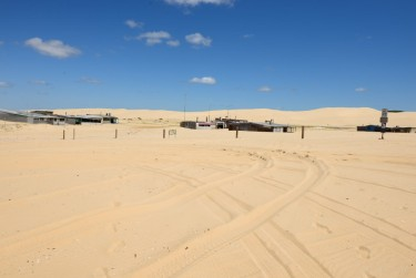 Houses in the middle of the sand dunes. Left over from an old movie set?