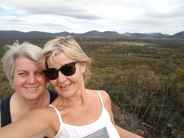 Selfie of me and my sister at the top lookout, looking into Wilpena Pound