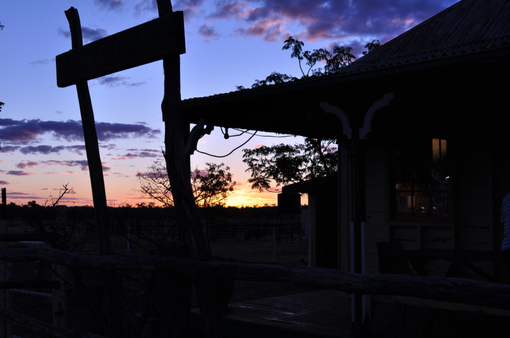View from the veranda of the Middleton Pub with the sky blazing purple at sunset