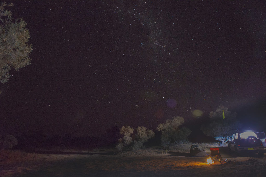 The milky way is a streak through the sky over my campsite in the Simpson Desert