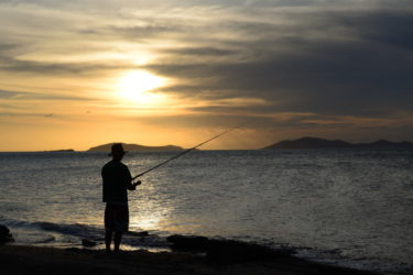 Fishing in the golden rays of sunset