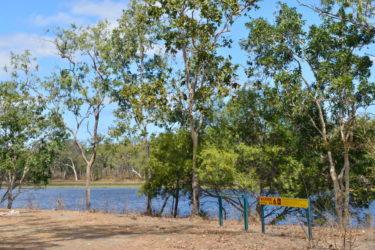 Beware crocodiles sign at the lagoon where Doc is fishing
